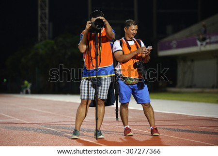 BANGKOK THAILAND- AUG 16: The photographer in action during the competition Thai Premier League 2015 between BEC and Chonburi FC at Minburi Stadium on August 16, 2015 in Bangkok, Thailand. - stock photo