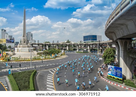 "Bangkok,THAILAND, AUG 16-2015 : This event is ""Bike for mom "" from Thailand. Bike for mom event show respected to Queen and make Thailand's cyclists set record for world's biggest bike ride. - stock photo"