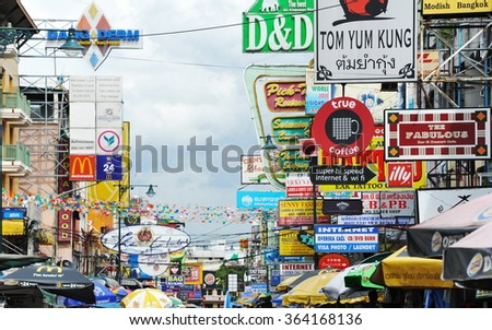 BANGKOK, THAILAND - AUG 21, 2013: View of business signs along popular backpacker destination Khao San Road. The area is famous for its street market, budget accommodation and lively bar scene. - stock photo