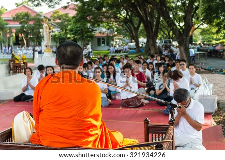 BANGKOK,THAILAND-August 15, 2015: A monk is preaching in front of group of people during religious ceremony - stock photo
