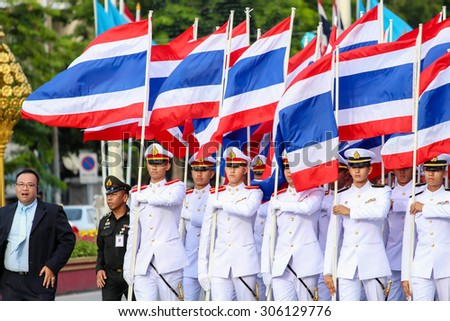 BANGKOK, THAILAND - AUGUST 12: Cadets of the Royal Thai Army and Navy hold flag in mother's day celebration parade on August 12, 2015 in Ratchadamnoen Klang road, Bangkok, Thailand