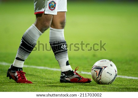 BANGKOK THAILAND-AUGUST16:close up of a soccer shoe  during  the Thai Premier League between Muangthong UTD. and Samutsongkhram FC at SCG Stadium on Aug 16,2014 in Thailand. - stock photo