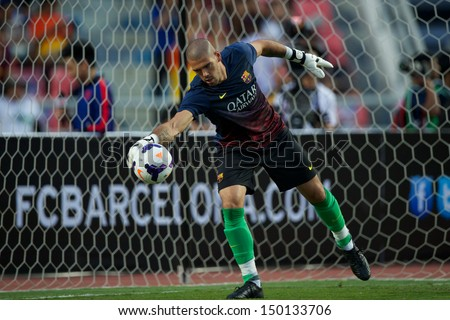 BANGKOK,THAILAND-AUGUST07:Goalkeeper V�ctor Valdes of FC Barcelona in action during the international friendly match Thailand XI and FC Barcelona at Rajamangala Stadium on August 7,2013 in,Thailand. - stock photo