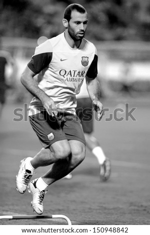 BANGKOK, THAILAND - AUGUST 06: Javier Mascherano of FC Barcelona jumping during FC Barcelona training session at Rajamangala Stadium on August 06, 2013 in Bangkok, Thailand.