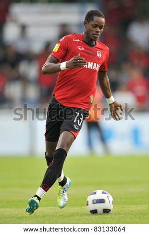 BANGKOK, THAILAND- AUGUST 20: Kouakou Yao Christian of MTUTD in action during Thai Premier League (TPL) between TOT SC and Muangthong United on August 20, 2011 at TOT Stadium in Bangkok, Thailand - stock photo