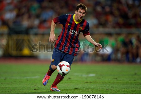 BANGKOK,THAILAND-AUGUST07:Lionel Messi of FC Barcelona in action during the international friendly match between Thailand XI and FC Barcelona at Rajamangala Stadium on August 7,2013 in,Thailand.