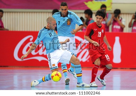 BANGKOK,THAILAND AUGUST24:Miguel Sayago (blue no.11) of Spain for the ball during Friendly match between Thailand and Spain at Nimibutr Stadium on August24,2012 in Bangkok Thailand