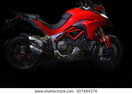 BANGKOK THAILAND - AUGUST 09 ; Motorcycle Dealer showing motorcycle sports a large red and white to show a lot of interest from on August 9, 2015 in Bangkok, Thailand. - stock photo