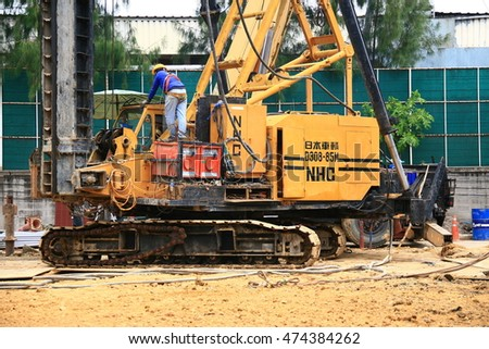 bangkok ,thailand - august 13,2016 : pile driver machinery working auger for piling work.