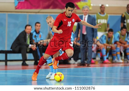 BANGKOK,THAILAND AUGUST24:Sarawut Jaipech (red no.16) of Thailand for the ball during Friendly match between Thailand and Spain at Nimibutr Stadium on August24,2012 in Bangkok Thailand
