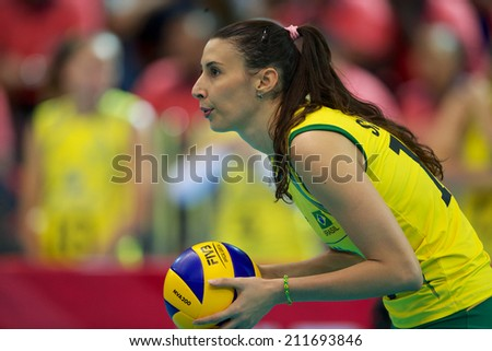 BANGKOK,THAILAND-AUGUST15:Sheilla	Castro De Paula  in action during the FIVB Women's World Grand Prix 2014  Brazil and USA at Indoor Stadium Huamark on Aug.15, 2014 in Thailand.