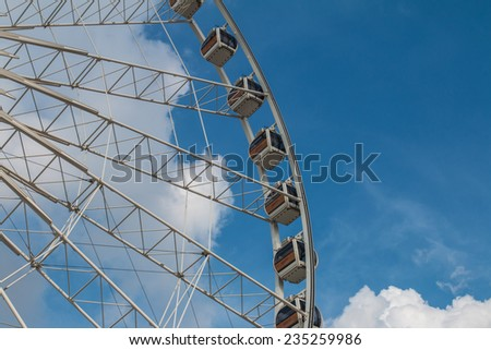 Bangkok Thailand - 01 August,2014:The photo of ferris wheel with blue sky at Asiatique The Riverfront