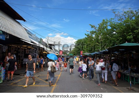 BANGKOK, THAILAND - AUGUST 22, 2015: Unidentified tourist at Jatujak or Chatuchak Market. Here is the largest weekend market open from 8am to 6pm in Thailand - stock photo