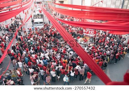 Bangkok, Thailand -CIRCA November 2013, Red shirt army protest gathering in Bangkok Ratchaprasong junction. - stock photo