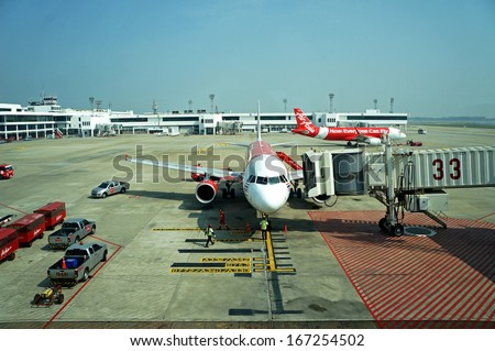 BANGKOK THAILAND DEC 9 2013: Air Asia plane ready for boarding in Bangkok on 9 December 2013. Air Asia is one of the company that ready for the open of AEC by flying to most of the country in Asia - stock photo