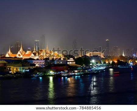 BANGKOK, THAILAND Dec 23, 2017 : Night time view of the Grand Palace and the Temple of the Emerald Buddha (Wat Phra Kaew) at the side of the Chao Phraya River in Bangkok.