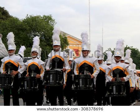BANGKOK, THAILAND - DEC 5 : Students parading during the celebration of the 87th birthday of H.M. King Bhumibol Adulyadej in Bangkok, Thailand on December 5, 2014. - stock photo