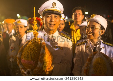 BANGKOK, THAILAND - DEC 05, 2014: Unidentified participants in the celebration of the 87th birthday of Thailand King Bhumibol Adulyadej, is also known as Rama IX, ninth monarch of Chakri Dynasty. - stock photo