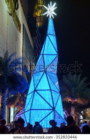 Bangkok, Thailand - December 3, 2015: Blue Lighting Christmas Tree, Front of Siam Paragon shopping mall - stock photo