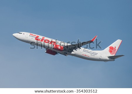 BANGKOK, THAILAND - DECEMBER 20, 2015: Boeing 737-9GP(ER) registration number HS-LTT of Thai Lion Air flight SL8506 flying from Don Mueang Airport (DMK) to Chiang Mai Airport (CNX) - stock photo