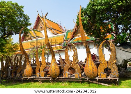 BANGKOK, THAILAND - DECEMBER 12, 2014: Buddhist temple Wat Suthat, a royal temple of first grade, one of ten such temples in Bangkok -23 in Thailand-, construction was begun by King Rama I in 1807 - stock photo