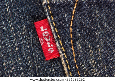 BANGKOK, THAILAND - DECEMBER 09 2014: Close up of the LEVI'S red label on the back pocket of denim jeans. LEVI'S is a brand name of Levi Strauss and Co, founded in 1853. - stock photo