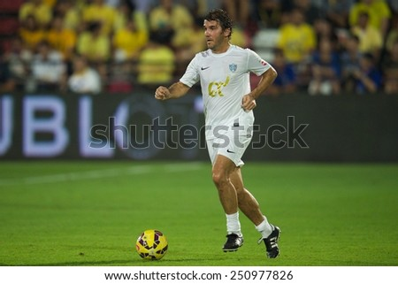 BANGKOK, THAILAND - DECEMBER 05:Karl-Heinz Riedle of team Figo runs with the ball during the Global Legends Series match, at the SCG Stadium on December 5, 2014 in Bangkok, Thailand.  - stock photo