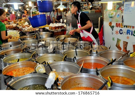 Bangkok, Thailand - December 16, 2011:  Large cauldrons filled with delicious Thai foods at the Chatuchak Park Or Tor Kor Fresh Produce & Food Market - stock photo