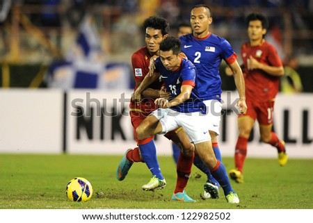 BANGKOK THAILAND-DECEMBER 13:Mohd Amar Rohidan #12 of Malaysia (blue) in action during the AFF Suzuki Cup between  Malaysia and Thailand at Supachalasai  stadium on Dec13, 2012 in,Thailand.