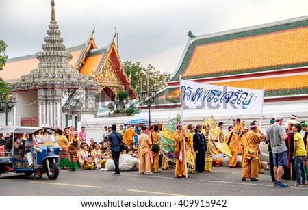 Bangkok, Thailand - December 5, 2015: Participants of the festive procession during the celebration of the King Rama 9 birthday at the walls of the Grand Palace, Bangkok, Thailand. - stock photo