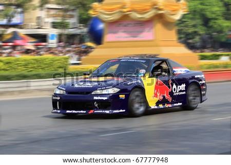 BANGKOK,THAILAND - DECEMBER 18: Red Bull Racing Team speeding shows on Street of Kings, Ratchadamnoen Red Bull Bangkok 2010. December 18, 2010 in Bangkok,Thailand - stock photo