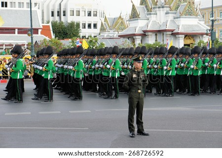 Bangkok, Thailand - 2 December 2014: Soldiers perform the marching of the colors military parade, showcasing Thailand's strength to celebrate the 87th birthday of His Majesty King Bhumibol Adulyadej - stock photo