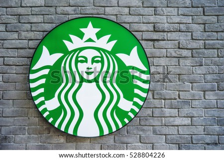 Bangkok, THAILAND - December 4, 2016: Starbucks coffee shop sign on brick wall. Starbucks is the largest coffeehouse in the world.