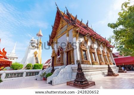 BANGKOK, THAILAND - DECEMBER 14, 2014: temple Wat Intharawihan in Bangkok. It was built at beginning of Ayutthaya period, one of the main features is a 32-metre high, 10-metre wide standing Buddha - stock photo