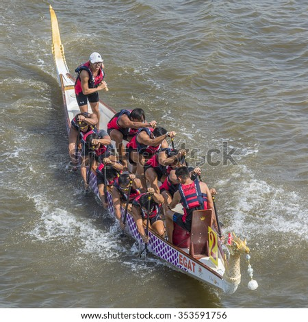 Bangkok, Thailand 19 December 2015 : Two rowing teams in full speed during  for competition of Thailand International Swan Boat Race 2015 at Chao Praya River Bangkok Thailand. 19 December 2015