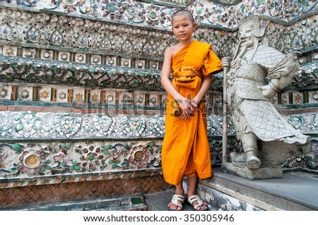 Bangkok, Thailand. December 2012. Unidentified boy monk at the Buddhist temple Wat Arun - stock photo