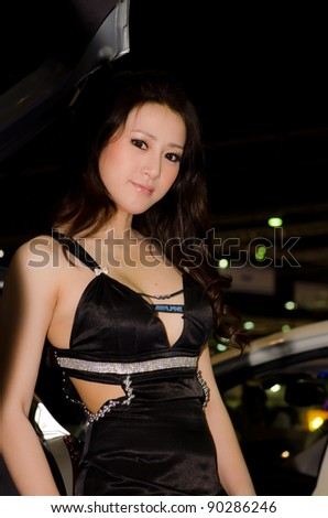 BANGKOK, THAILAND - DECEMBER 6: Unidentified female presenter at Alpine booth in THE 28th THAILAND INTERNATIONAL MOTOR EXPO 2011 on December 6, 2011 in Bangkok, Thailand. - stock photo