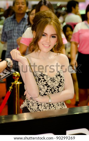 BANGKOK, THAILAND - DECEMBER 6: Unidentified female presenter at RUF booth in THE 28th THAILAND INTERNATIONAL MOTOR EXPO 2011 on December 6, 2011 in Bangkok, Thailand. - stock photo