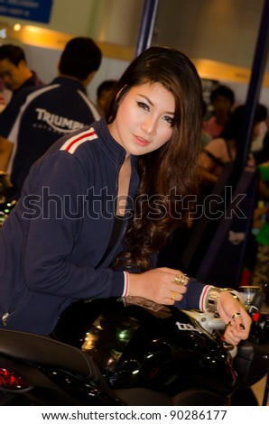 BANGKOK, THAILAND - DECEMBER 6: Unidentified female presenter at Triumph booth in THE 28th THAILAND INTERNATIONAL MOTOR EXPO 2011 on DeCember 6, 2011 in Bangkok, Thailand. - stock photo