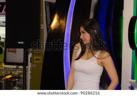 BANGKOK, THAILAND - DECEMBER 6: Unidentified female presenter in THE 28th THAILAND INTERNATIONAL MOTOR EXPO 2011 on December 6, 2011 in Bangkok, Thailand. - stock photo