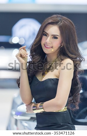BANGKOK, THAILAND - DECEMBER 11: Unidentified model with MG Car on display at The 32nd Thailand International Motor Expo on December 11, 2015 in Bangkok, Thailand.