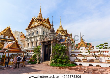 BANGKOK, THAILAND - DECEMBER 16, 2014: unidentified people at The Grand Palace, that was the residence of the Kings since 1782. It is one of the most popular tourist attractions in Thailand. - stock photo