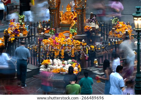 BANGKOK,THAILAND - 21 DECEMBER : Unidentified people pray respect the shrine of the four-faced Brahma statue at Ratchaprasong Junction on December 21, 2014 in Bangkok capital city,Thailand. - stock photo
