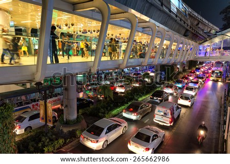 BANGKOK, THAILAND, DECEMBER 25, 2014: View on the aerial BTS walking platform and the transportation traffic in Sukhumvit road in Bangkok, Thailand - stock photo