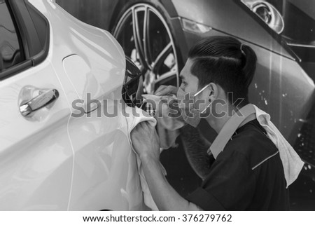 Bangkok, Thailand - December 12, 2015 : Washing white car by hand using a foam preparation for polishing.
