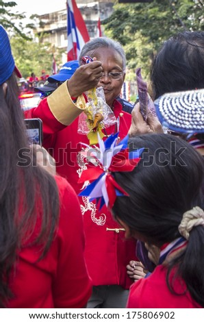 Bangkok, Thailand - FEB 1, 2014: Anti-government protesters in  Bangkok's Chinatown donate to Suthep Thaugsuban, the PDRC leader, during a march.