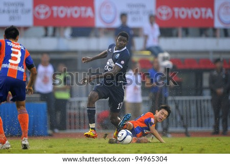 BANGKOK,THAILAND-FEB 4: Bouba Abbo of Buriram PEA (blue) in action during the Toyota league cup  Buriram PEA and Thai Port FC.at National Stadium on FEB 4, 2012 in Bangkok, Thailand.