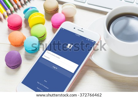 BANGKOK ,THAILAND - FEB 06, 2016: Login Screen Facebook icons on Apple iPhone 6. Facebook is largest and most popular social networking site in the world. - stock photo