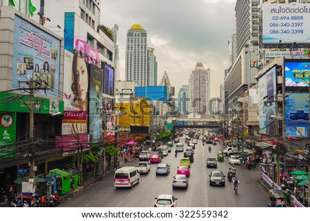BANGKOK, THAILAND - FEB 20, 2015: Ordinary street scene with transport . Bangkok is one of the most important economic and transport centres in South-East Asia - stock photo