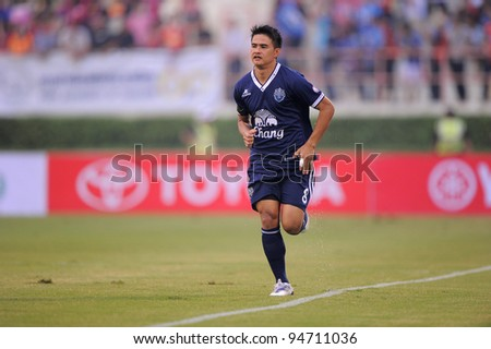 BANGKOK,THAILAND-FEB 4: Suchao Nuchnum (blue) of Buriram PEA in action during the Toyota league cup final between Buriram PEA and Thai Port FC.at National Stadium on Feb 4, 2012 in Bangkok, Thailand.